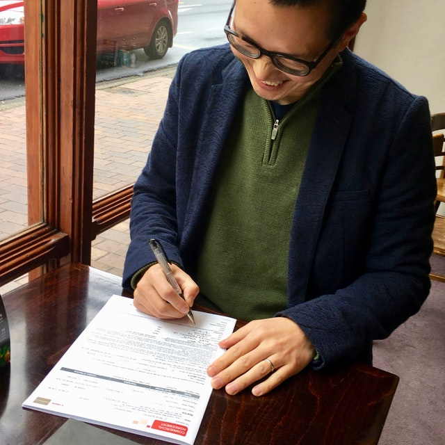 Alex signing the contract for the digital press