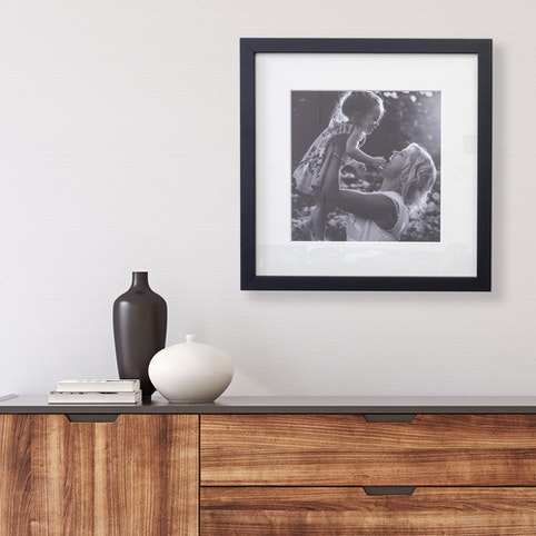 """12x12"""" framed print with warm white mat and black box frame."""