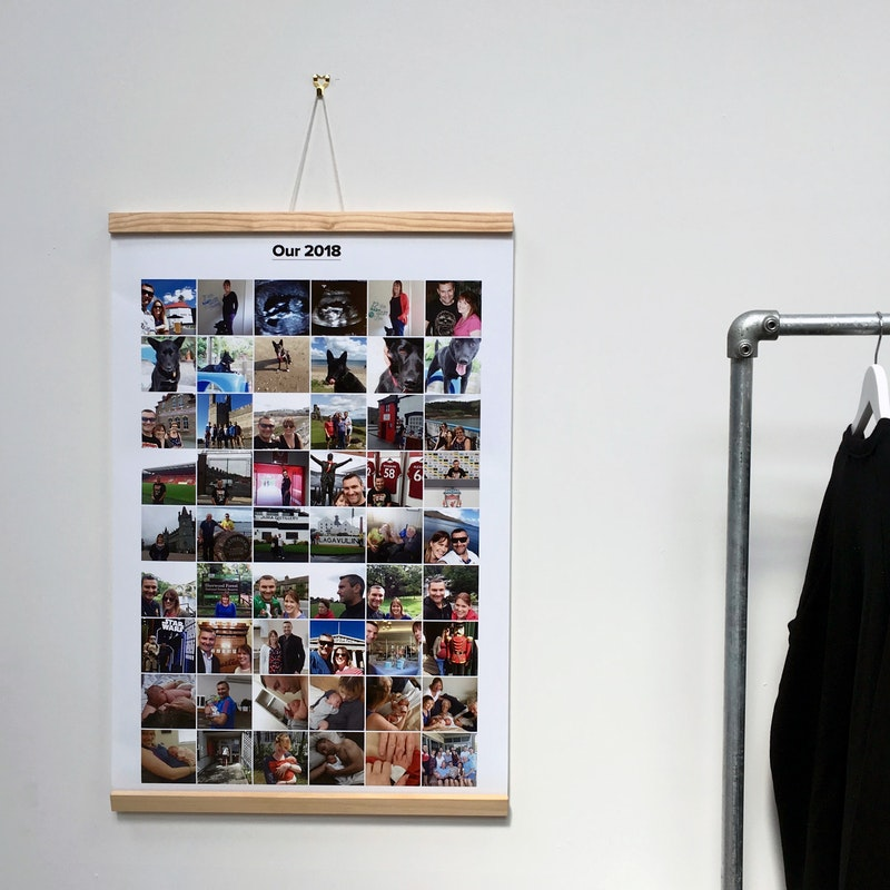 A 24x36 Our 2018 poster hung with a wooden hanger