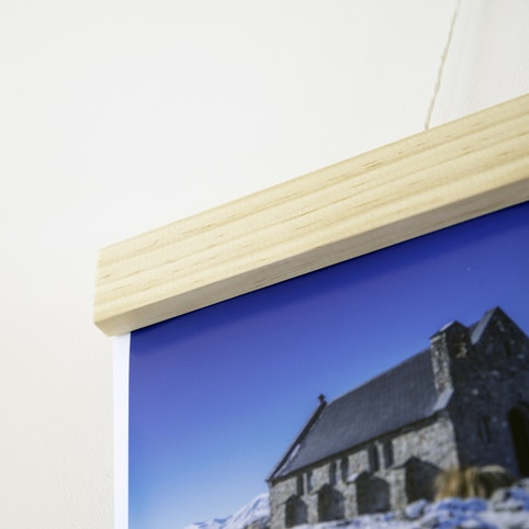 Wooden hangers are an alternative to framing.